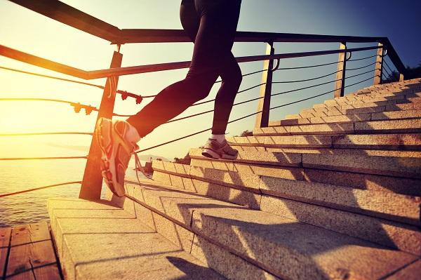 A woman's legs as she's running up stairs on her morning jog.