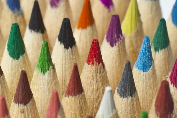 Pencil tops in different colours including green, blue, yellow, purple, red and black symbolising diverse hiring.