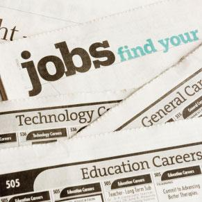 Close up of newspapers with jobs and career listings.