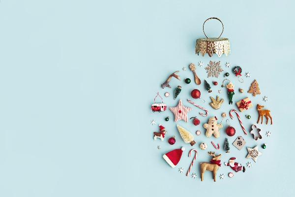 A Christmas ornament made up of tiny little symbols of Christmas, including a santa hat, candy canes, and Christmas trees.