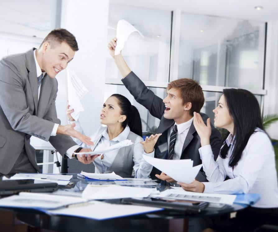 Business people in a conflict at work, arguing with negative emotions and negative mental health implications.