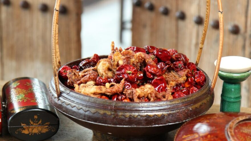 A basket of dried chillis and chicken and spices sitting outside of Hutong, an Asian restaurant in the City of London.