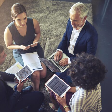 High angle shot of a group of businesspeople in human resources jobs using their digital tablets.