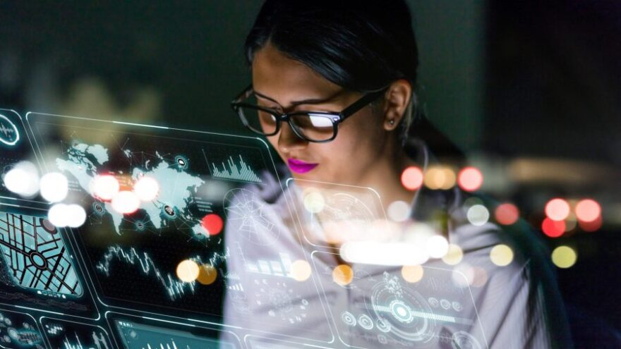 A female engineer is looking at information on an interface, thinking about how technology is affecting the future of work.