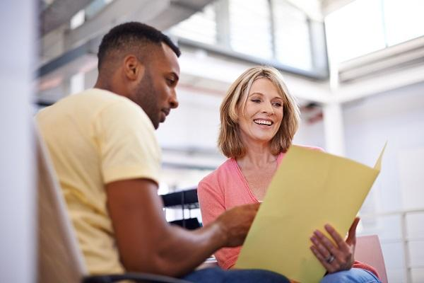 Man and woman talking in an open plan office