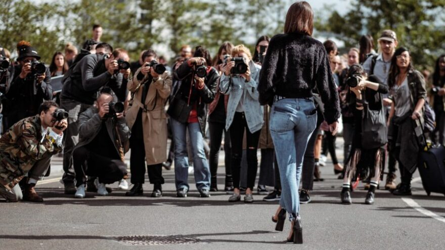 Celebrity walks towards paparazzi