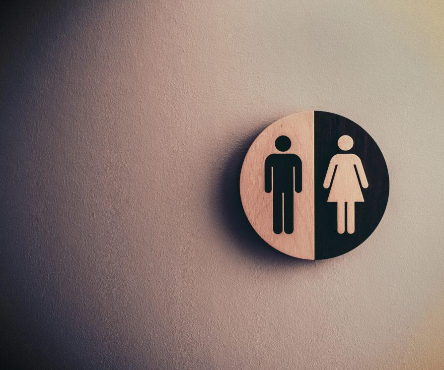 Shot of a female / male sign on a blank wall