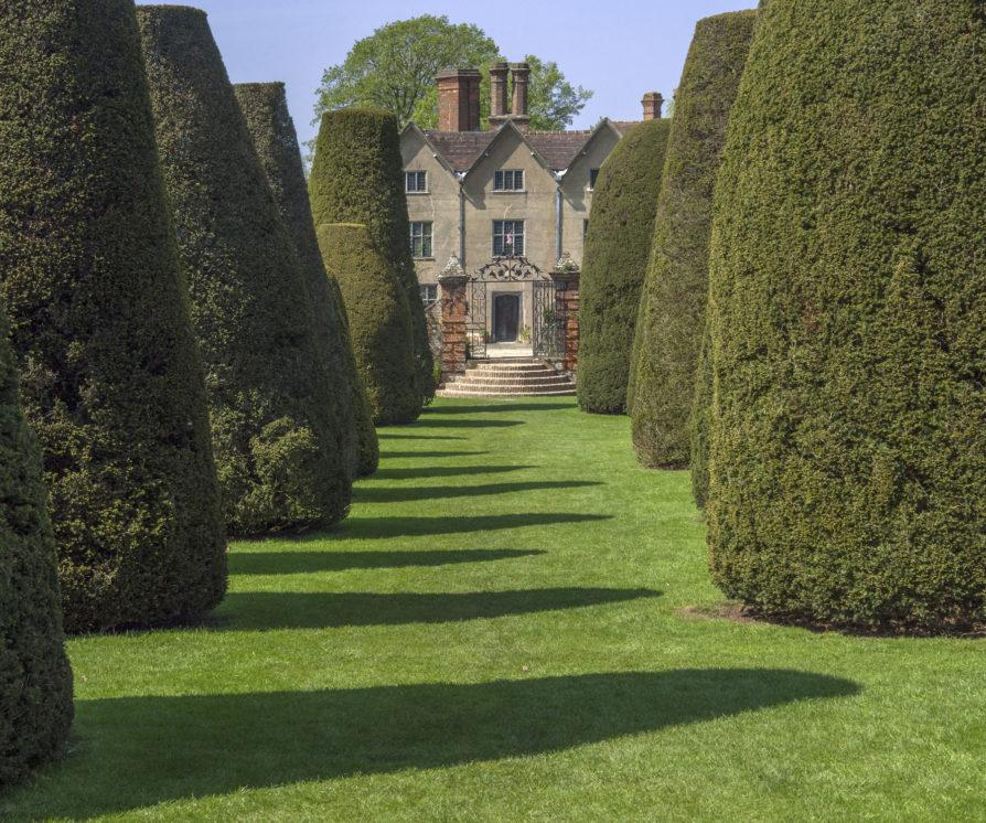 Country house with hedges leading up to the front door
