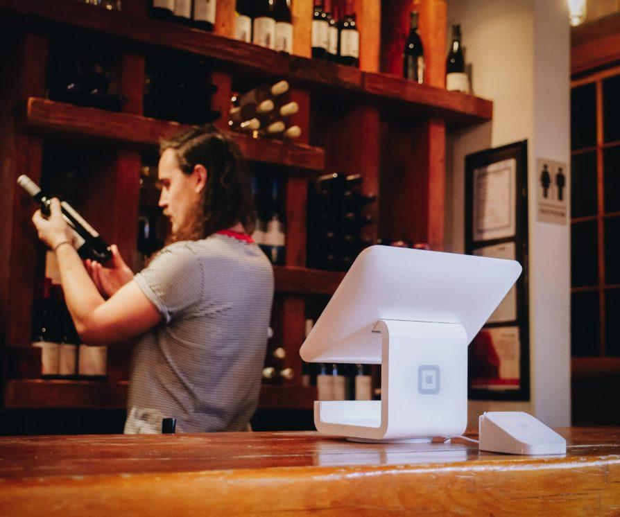 restaurant host looking at wine