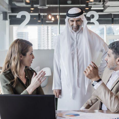 Business people discussing global business in modern office
