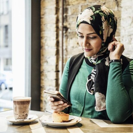 Woman on the phone in a cafe
