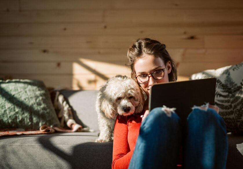 Woman working at home with dog