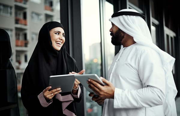 Two colleagues in hijab, smiling